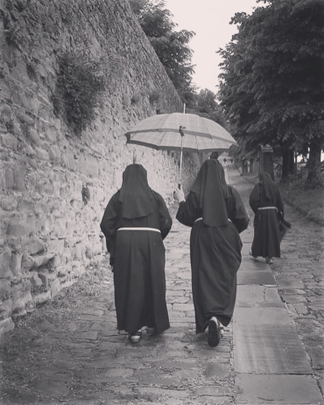Three nuns climbing the Via Santa Margherita  in Cortona.