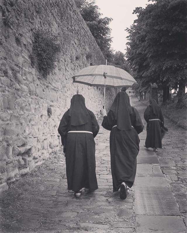 Three nuns climbing the Via Santa Margherita  in Cortona.